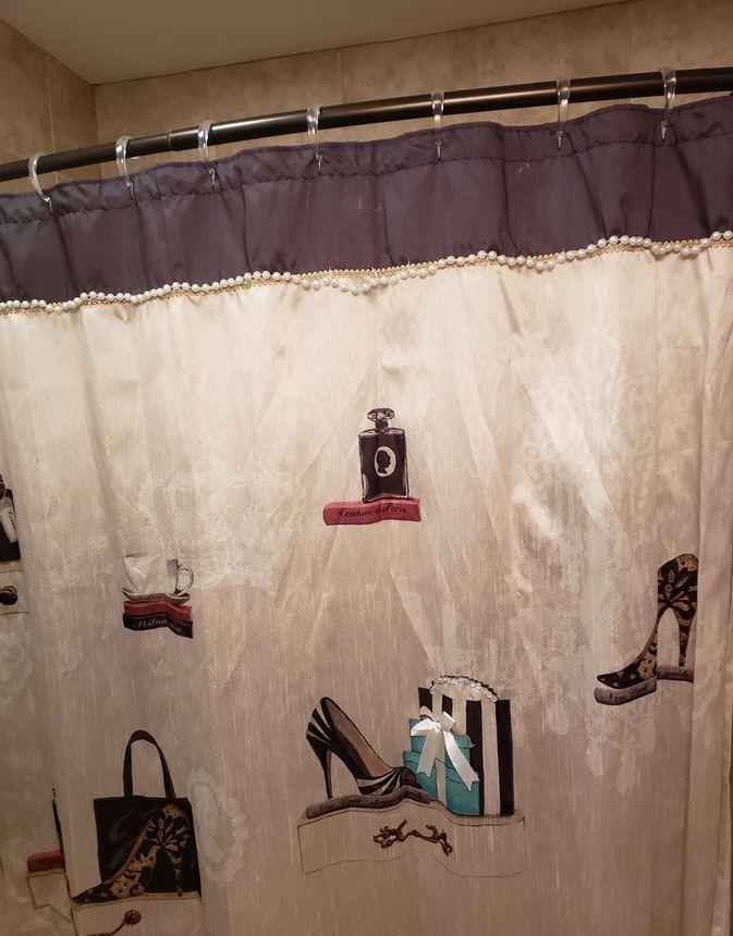 I want a bathroom with neutral décor—not a girly shower curtain.