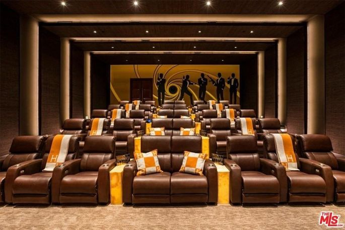 The 40-seat theater with Hermès cushions
