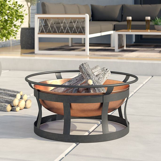 A three-season steel fire pit is a smart addition to the yard.