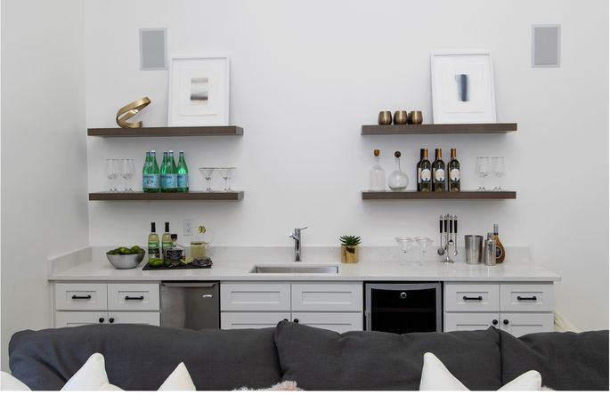 This wet bar with open shelving was easy to add, and made a big difference in the room.