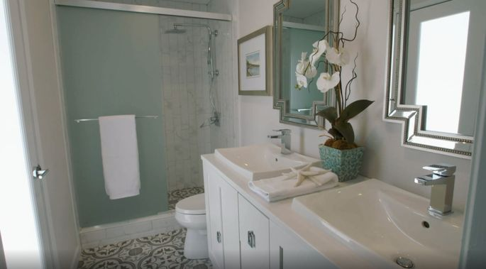 With a poolside door, this bathroom is beautiful and convenient.