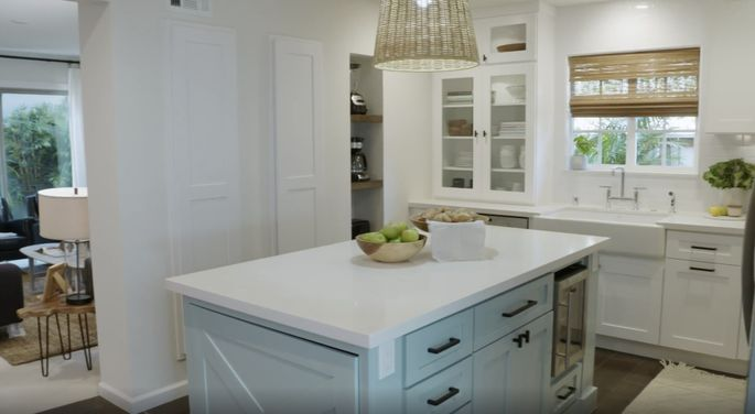 With white perimeter cabinets and white quartz counters, this light blue island looks beautiful.
