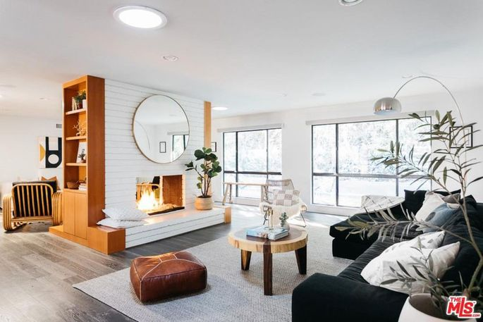 Living room with dual-sided fireplace
