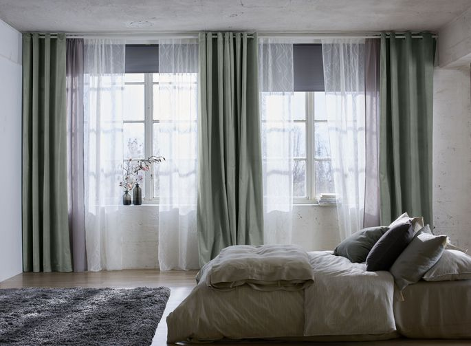Changing out the heavier curtains in this Ikea bedroom makes a huge difference.