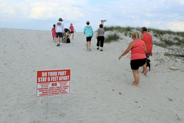 People access Jacksonville Beach in Florida.