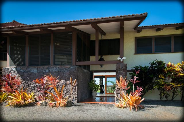Front entry with volcanic rock