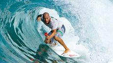 Pro Surfer Kelly Slater Scores a Beautiful Spot on Oahu's North Shore