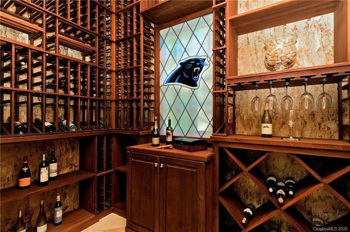 Custom wine cellar with Panthers logo