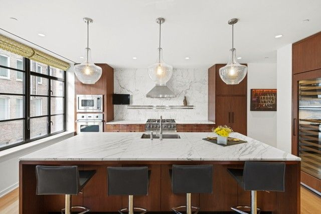 Kitchen with marble counters and backsplash