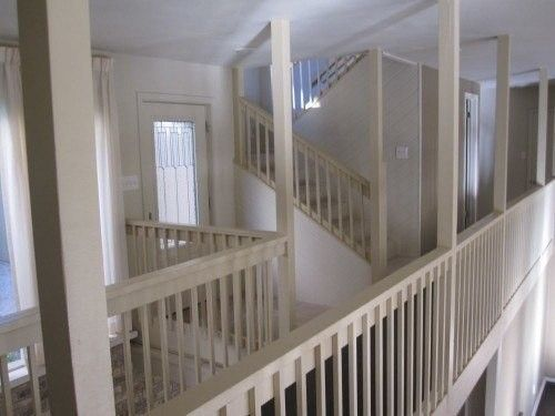 Before: Old stairs and railings painted white