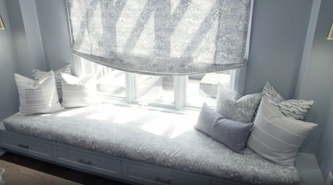 With a bright window, this spot is a perfect place to relax and read.