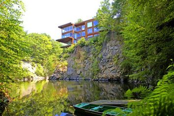 Cliffside & Cantilevered: Bedford House Overlooking Spring-Fed Quarry
