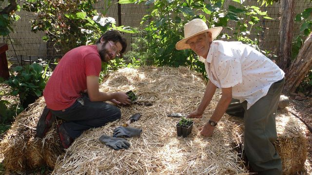 Members of the Los Angeles Eco-Village doing some gardening.