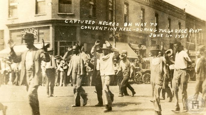 Photo from Tulsa Historical Society showing African Americans being led to the Convention Hall during the 1921 Tulsa Race Riot/Massacre.