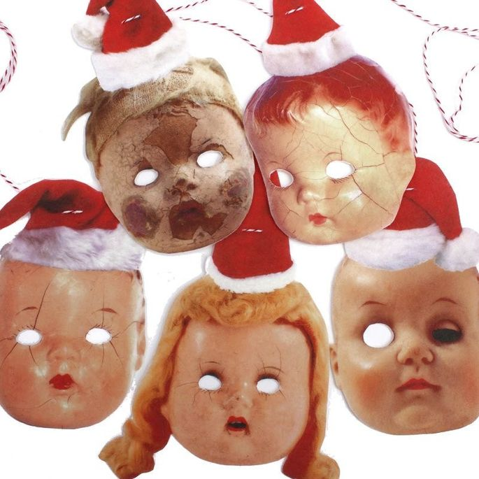 Trim the tree with doll heads wearing Santa hats!