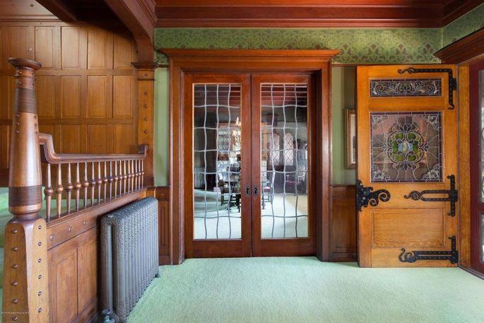 Original doors, woodwork, glass, radiators, and stenciling