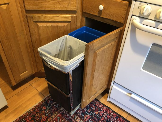 An in-cabinet trash can keeps trash out of sight and out of mind until you need to throw something away.
