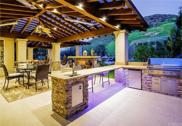 California room with fireplace and outdoor kitchen