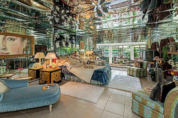 The mirrored master bedroom