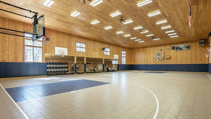 Hoop dreams seven homes with indoor basketball courts for Sport court utah