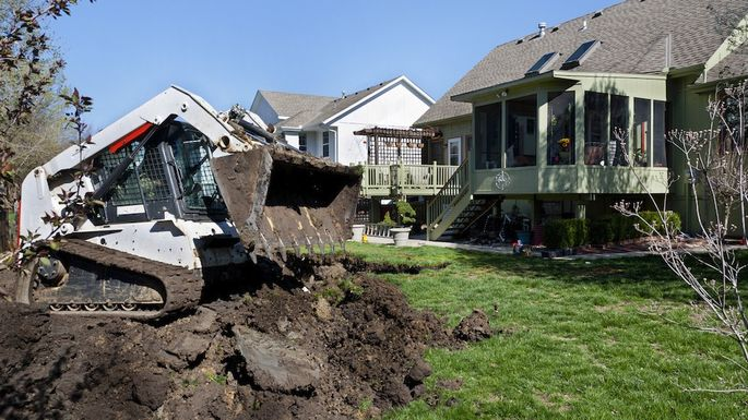 Bulldozer Scoops Dirt for a New Swimming Pool