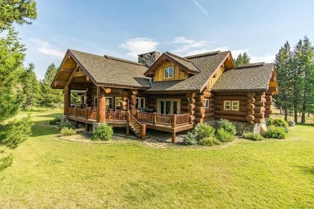 Log home swimming pool dream house Pioneer Log Homes of