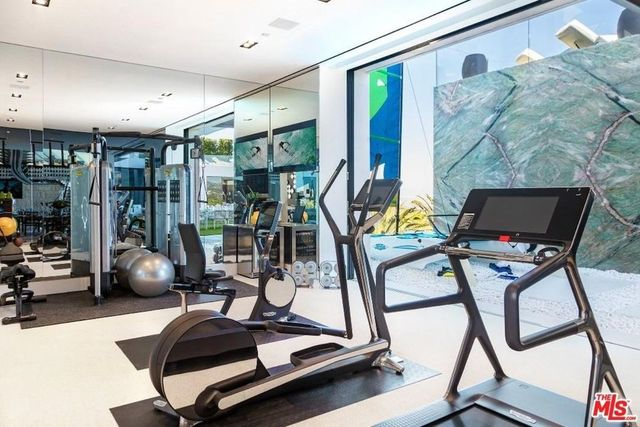 Gym with state-of-the-art, and a trainer, if you so desire.