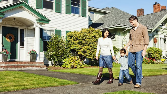 Happy Family Taking a Walk in The Neighborhood