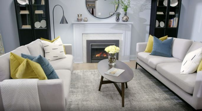 This clean, white fireplace is perfect for a contemporary living room.