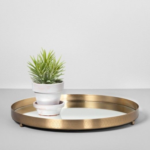 This tray with a neutral brass trim is one of the most versatile pieces in the collection.