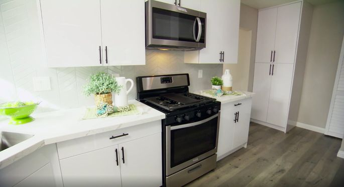 A light palette makes this kitchen seem larger.