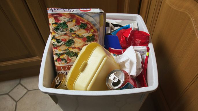 Rubbish bin filled with empty food packaging, close-up