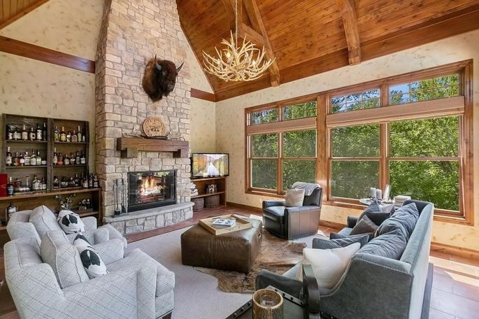 Four-season porch with stone fireplace