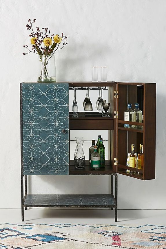 A retro-looking bar cabinet keeps all your barware organized.