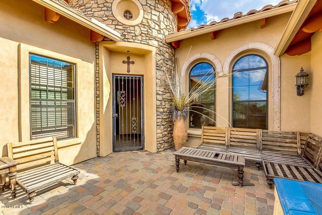 Gated patio with seating