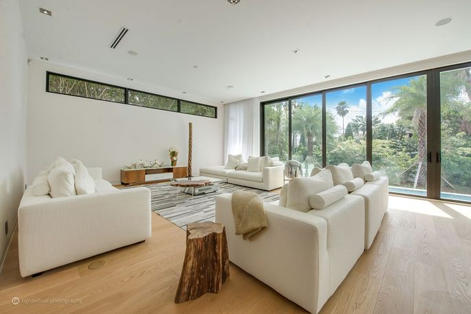 Living room with wall of glass doors