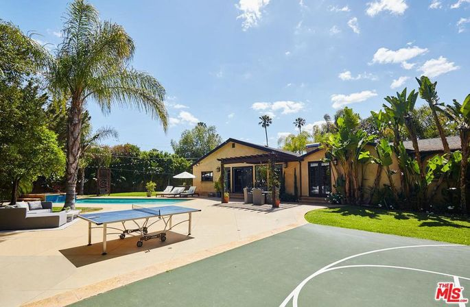 Backyard with saltwater pool and sport court