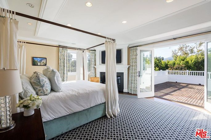 Master suite with fireplace and deck