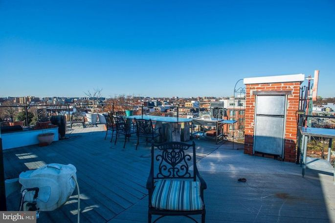 Private roof deck with city views