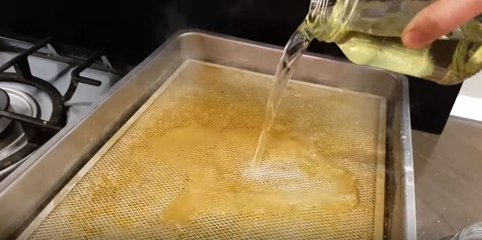 Slowly pour vinegar into a pan of simmering water.