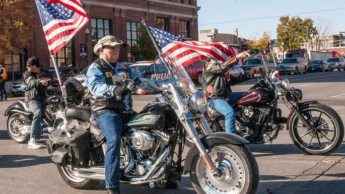 Members of the Patriot Guard Riders take part in the Veterans Day Parade in Emporia, KS.