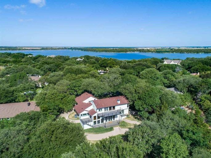 Aerial view of the property, with Lake Waco in the background