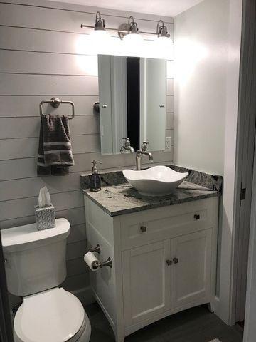 New ttoilet, vanity, sink and shiplap