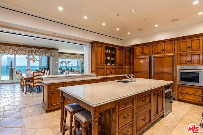 Kitchen with granite counters and a large island
