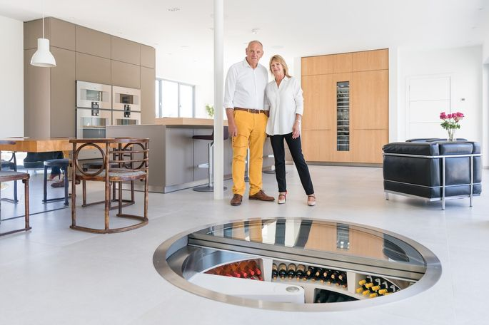 Nigel and Vanessa Slydell at the opening of their ultramodern 1,400-bottle cellar in their home in Chichester, England.