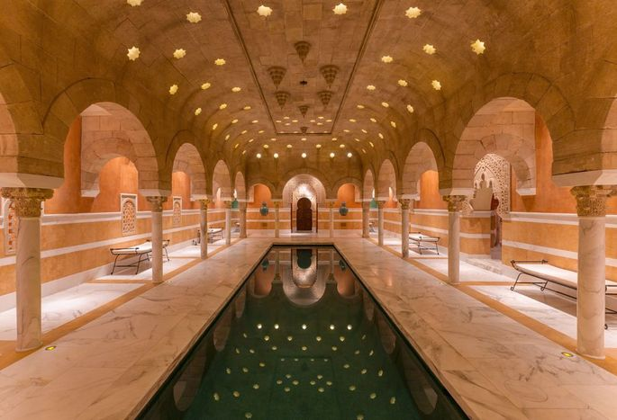 Moroccan tribesmen were hired to create the carved sandstone ceilings and archways in the 10,000-square-foot Hammam spa at Hacienda de la Paz.