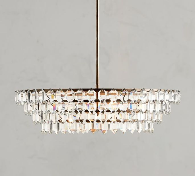 Light the way with this crystal and pewter stunner.
