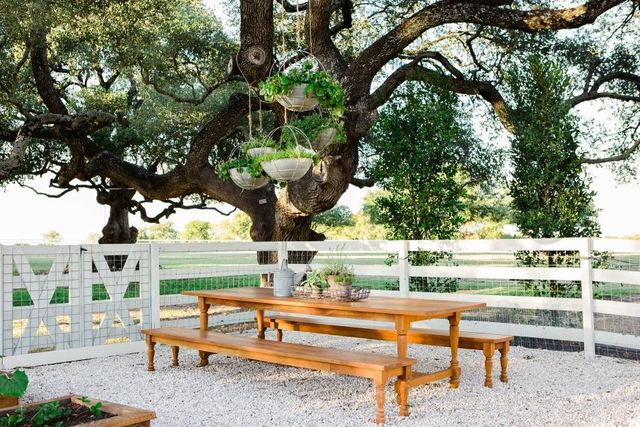 Clint Harp custom crafted a beautiful table of durable teak wood to sit under the oak tree.