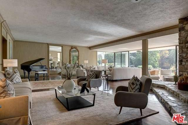 Formal living room with walls of windows