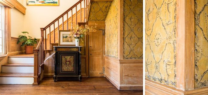 The entryway has the original painted decoration on the plaster walls.